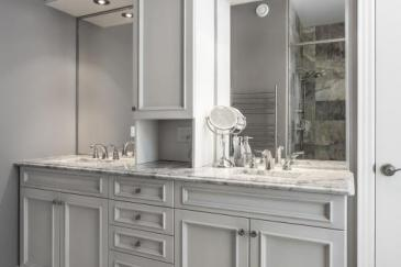 Light gray bathroom cabinets and bathroom remodeling in South Florida