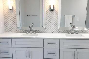 Custom herringbone tile look on wall for bathroom remodeling in Kendall, FL