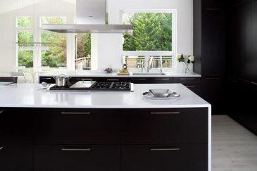 Dark kitchen with waterfall countertop