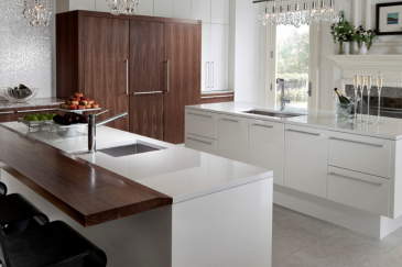 Custom kitchen cabinets in Coral Gables with white and wood accents