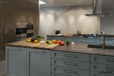 Dark gray kitchen cabinets, butcher block top, kitchen design