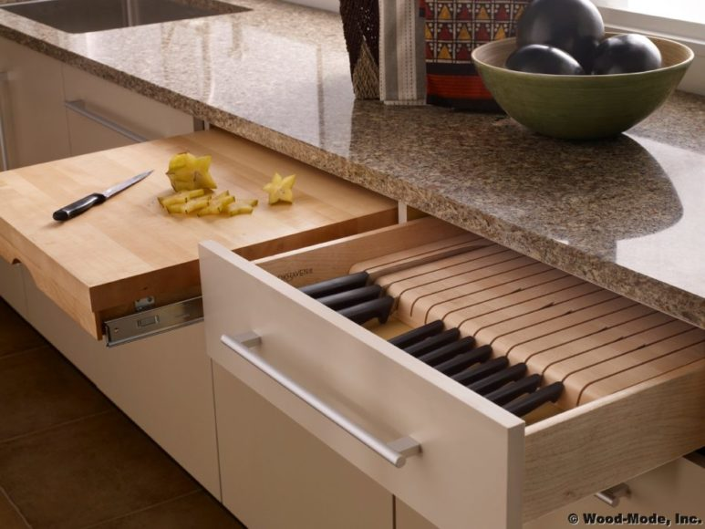 Custom kitchen cabinets in Brickell with cutlery sorting and pullout cutting board built in