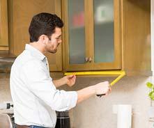 Kitchen cabinet design in Miami being measured