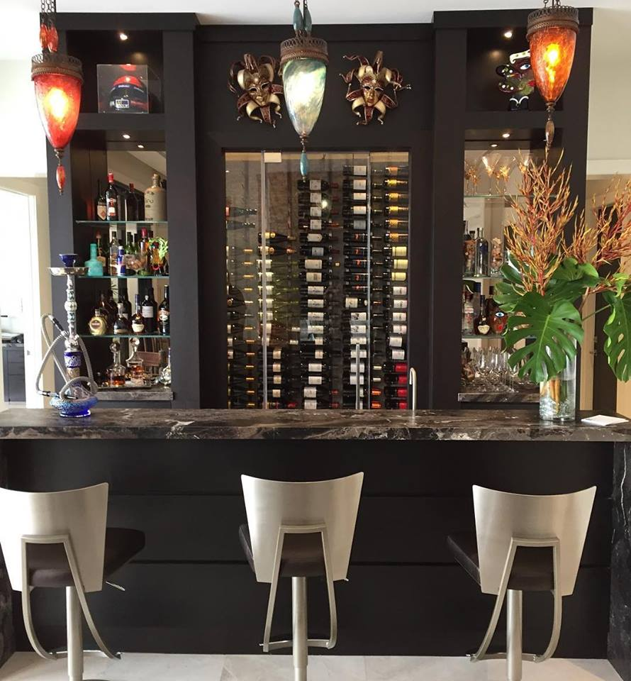 Custom home bar in Coral Gables with black with modern stools and light fixtures